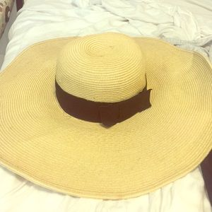 Floppy hat with black ribbon and bow